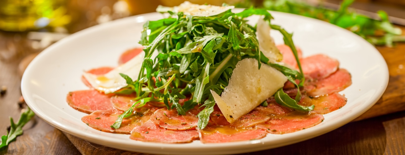 BEEF CARPACCIO WITH GRAPEFRUIT MAYONNAISE, RUCOLA, CELERY AND CAPER